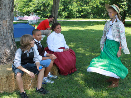 Reenactors dressed in period costume at a new Wickland event, the Wickland 19th-Century Barbecue, July 9, 2011. Pictured are, from left: Bryce Reiter, 11, Cox's Creek, Ethan Lamar, 11, Bardstown, Mackenzie Lamar, 9, Bardstown, and Cheyenne Kessinger, 11, Bardstown.