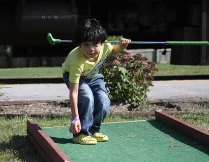 Braedan Blake, 4, Elizabethtown, plays mini golf while he waits for the train ride to start during a meet-and-greet day with SpongeBob SquarePants and his friend, Patrick the starfish, during their visit to the Kentucky Railway Museum in New Haven Sept. 25.