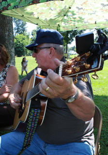 Joe Cissell joins other musicians and former members of the St. Gregory choir in singing country gospel songs at the Wickland 19th-Century Barbecue July 9.