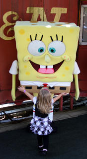Cheyenne Denton, 3, Stanford, had a great time dancing with SpongeBob SquarePants and his friend, Patrick the starfish, during their visit to the Kentucky Railway Museum in New Haven Sept. 25.