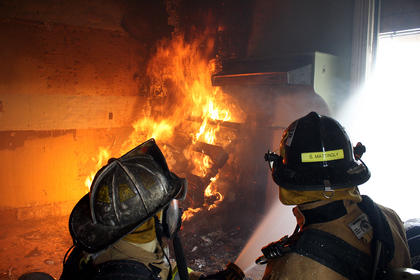 When the smoke becomes too thick, firefighters spray water through a window. The water drags much of the smoke out with it.