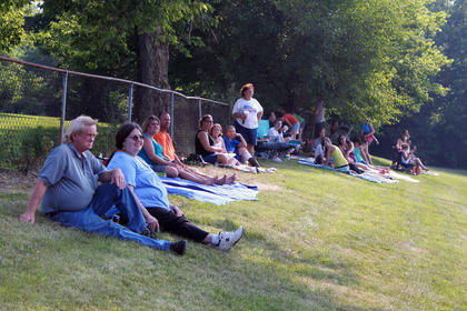 Visitors enjoy some time in the shade during a hot afternoon at the Bloomfield Picnic in the Park July 9, 2011.