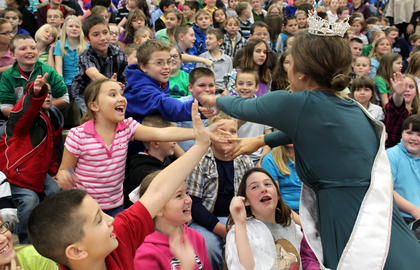 Ann Blair Thornton, Miss Kentucky 2011, high-fives with Foster Heights Elementary School students, including third-grader Gracie Farvour, during her visit to the school Dec. 7, 2011.
