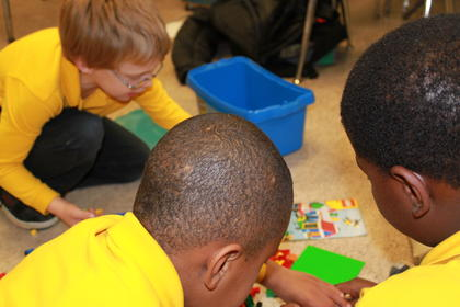 Mika McKnight , Andre Payne, and T.J. Wepzel  building at the Lego Club