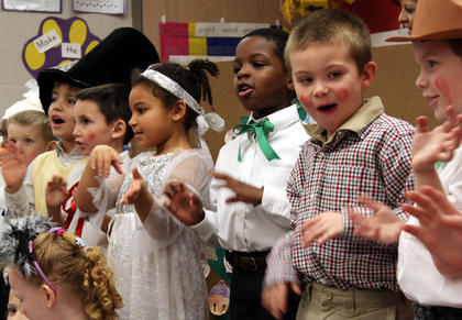"Students in Kristen O'Bryan's kindergarten class at Bardstown Primary sing a Christmas song after the performance of a play called ""The Christmas Box"" Dec. 15 in front of an audience of parents and relatives."