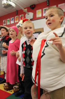 "Cade Boone, ""Humpty Dumpty,"" right, and Landen Lucas, the ""Ten o' Clock Scholar,"" second to right, sing a Christmas song alongside their fellow kindergartners following a performance of ""The Christmas Box"" in the class of Kristen O'Bryan at Bardstown Primary School Thursday."