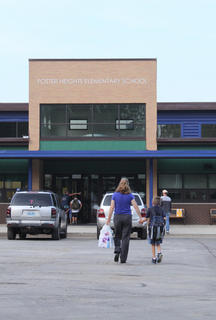 A parent and child approach Foster Heights Elementary School in Bardstown on the first day of the 2011-2012 school year Aug. 3.