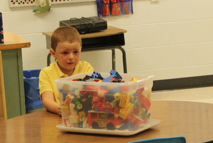 Dakota Ballard is nervous about the first day of school as he sits in the kindergarten class of his new teacher, Toni Ice, at Foster Heights Elementary Aug. 3.