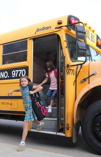 Third-grader Emily Williams gets off the bus on the first day of the 2011-2012 school year at Foster Heights Elementary Aug. 3.