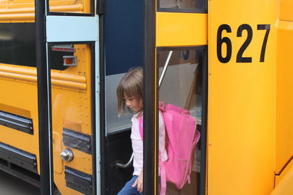 Kindergartner Emilee Paige Haley gets off the bus during her first day of school Aug. 3, 2011. later told Foster Heights office staff she got off the bus all by herself.