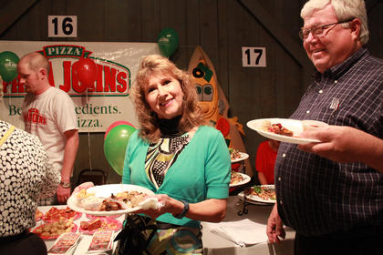 Sheila Spalding and Brian Papenfuss enjoy food from Bardstown Catering.