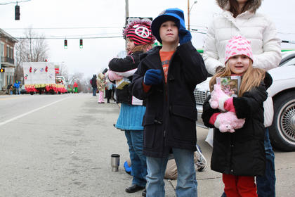 From left, Abbie, Jackson and Ava Culver snatched up some goodies handed out by parade participants.