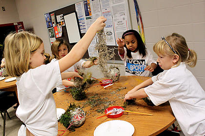 Students build a house for fairies at a Bardstown City Schools enrichment program Thursday. Pictured are, from left: first-grader Ava Hamilton, first-grader Alexis Jones, second-grader Maya McLendon and kindergartner Julia Brown.