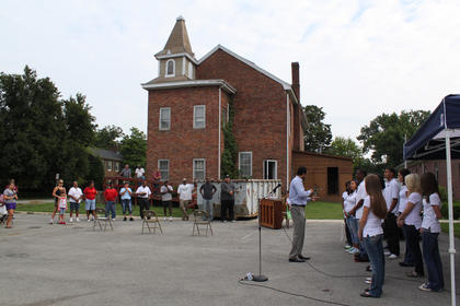 The Bardstown High School choir sings before the renovation of the 199-year-old former First Baptist Church in Bardstown kicks off Aug. 13. The choir members also helped in clearing out the church Saturday.