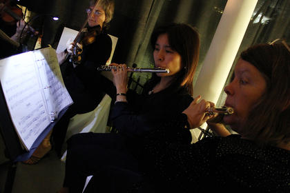 "Jayme Haslam, right, and Chie Ozaki of Silver & Strings perform at ""Build the Future with Bourbon and Bubbles,"" a fundraiser for the Guthrie Opportunity Center Saturday."