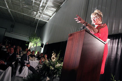 Linda Smith, who works for Opportunity Village in Las Vegas, speaks to the more than 340 people who attended a fundraiser for the Guthrie Opportunity Center Saturday evening. The center provides employment and resources for developmentally disabled adults.