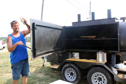 Doug Harris makes his own grills that work like convection ovens, in which the smoke circulates several times before exiting the grill. Harris cooked with wife Kim Harris and Col. Michael Masters on the Masters-Harris BBQ Team at the Bourbon City BBQ Festival Cook-off Sept. 3.