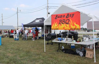 Bama Boy BBQ of Elizabethtown - with food cooked by Josh and Gretchen Lovelady - took Grand Champion at the first-ever Bourbon City BBQ Festival Sept. 2-3, 2011.