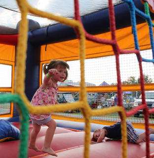 Caroline Buckman, 2, and Charlie Buckman, 3, enjoy the bouncie house at the Bourbon City BBQ Festival Sept. 3.