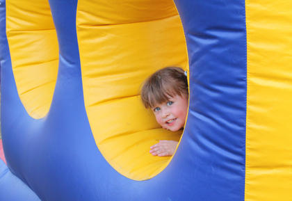 Caroline Buckman, 2, enjoys the Kids' Fun Zone at the Bourbon City BBQ Festival Sept. 3.