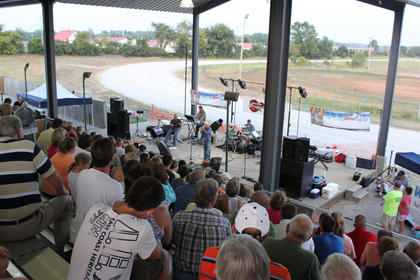E.J. Norsworthy, Murray, sang to a crowded grandstand at the Texaco Country Showdown state finals at the Nelson County Fairgrounds Sept. 3, 2011.