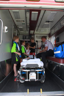 Nelson County EMS was at the Baby Fair giving tours of an ambulance. Touring the ambulance was Chris Arnold, Wyatt Roswall, Donovan Roswall, Alex Dadisman and Riley Roswall. Bernie Ayers with Nelson County EMS was giving the tours.