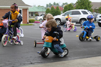 Payne Pence, 3, enjoys riding his tricycle at Little Angels Primary House's annual fundraiser for St. Jude Children's Hospital May 4.