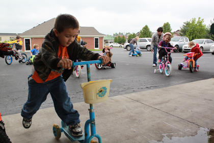 Payton Cassity, 3, brought his scooter to Little Angels Primary House's annual fundraiser Trike-a-thon for St. Jude Children's Hospital May 4.