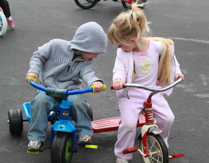 Owen Smith, 3, and Emma Workman, 3, get their trikes entangled at Little Angels Primary House's annual Trike-a-thon, a fundraiser for St. Jude Children's Hospital, May 4.