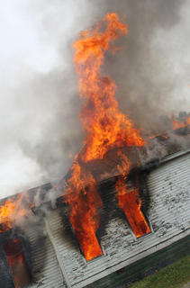 Flames rose up into the air as the house at 715 N. Third St. was burned to the ground. It was allowed to burn after the day was spent lighting and extinguishing smaller fires for training.