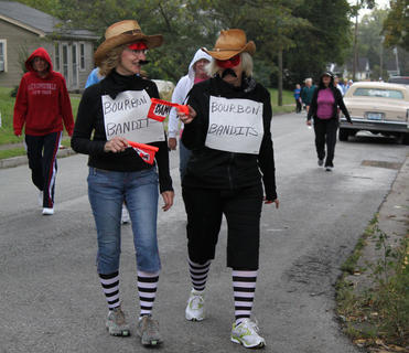 The Bourbon Bandits team turns the corner onto John Fitch Avenue during the 5K Spirit Run & Walk, the official kickoff to United Way's fall campaign, Saturday morning. Raffo Wimsett III, Bardstown, placed first in the men's category with a time of 18:16, while Roberta Meyer, Shepherdsville, came in first among women with a time of 19:36.