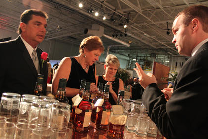 Chris Fletcher, Louisville, serves Buffalo Trace bourbon to guests at the Great Kentucky Bourbon Tasting & Gala Saturday evening.