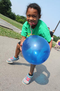 Kindergartner Kayla Grundy chases down a balloon.
