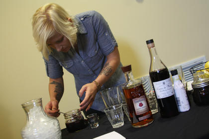 Jacquelyn Pobst, of Louisville, focuses as she mixes ingredients for the Mixed Drink competition Wednesday at the Best Western Hotel.