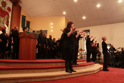 Teen Challenge interprets a song performed by the Community Choir into American Sign Language at the Martin Luther King Day celebration at St. Monica Church in Bardstown Jan. 17, 2011.