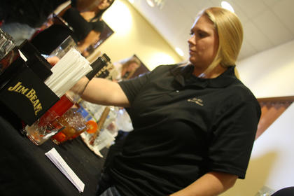 Angie Leak, who was representing the Old Talbott Tavern, prepares some mixed drinks at the mixed drink challenge Wednesday at the Best Western Hotel.