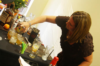 "Ginger Flowers, of Shelbyville, pours her ""Buddy's Maple Old Fashioned"" mixed drink Wednesday for the judges panel during the Kentucky Bourbon Festival Mixed Drink Challenge at the Best Western Hotel. Flowers, representing Jim Beam Distillery, won first place in the distillery division."