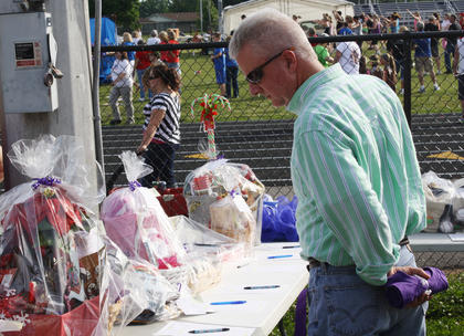 Steve Hart, Bardstown, reviews some of the baskets available for bidding in the silent auction.