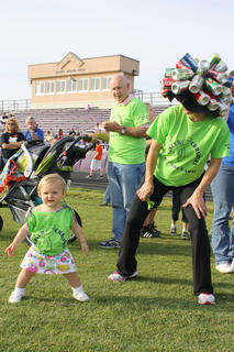 Kristen O'Bryan, Bardstown, right, dances along with her daughter, Grace, during Relay for Life Friday night.