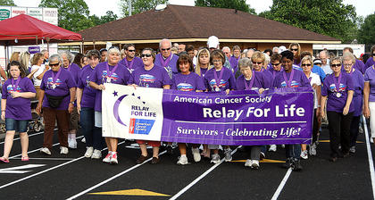 Local cancer survivors unite during the Survivors Walk. The Survivors Walk is always the first lap at Nelson County's Relay for Life.