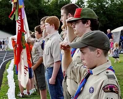 Troop 136 Boy Scouts salute the cancer survivors during the Survivors Walk.