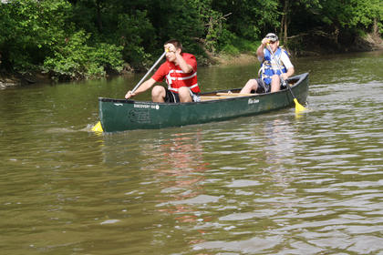Troop 147 Boy Scouts Nathan Broell and Frankie Dickerson paddle along Beech Fork River in search for litter.
