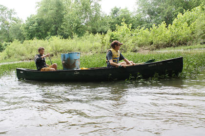 Luke Hagan and Jonah Stiles look for trash along the river, to go along with the items they've already picked up during the eighth annual Paddle Pick Up Saturday at Beech Fork River.