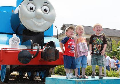 Pictured, from left: John Squires, 2, Amy Lee, 3, and Austin Lee, 3, came from Casey County and Georgetown to visit Thomas the Tank Engine at the Kentucky Railway Museum in New Haven June 4.