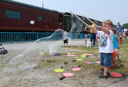 Aiden Parker, 3, Lexington, plays with bubbles, one of many activities offered during Thomas the Tank Engine's four-day visit to the Kentucky Railway Museum in New Haven beginning June 4.