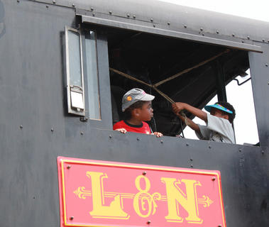 Chauncey Carthan, 5, looks down the track while Amarie Lockhart, 6, rings a train's bell at the Thomas the Tank Engine event and activities day at the Kentucky Railway Museum in New Haven June 4. Both came from Louisville to visit Thomas.