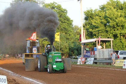 Greg Freed of Manchester, Tenn., wins his tractor pull competition with his John Deere tractor, Deere Traxx.