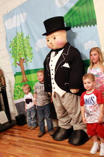 Children posed with Sir Topham Hatt, Controller of the Railway, during the Thomas the Tank Engine event and activities day at the Kentucky Railway Museum in New Haven June 4. Face painting was a new activity at the 2011 event.