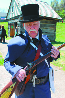 Re-enactor Ernie White of Huntington, Ind.,  displays a Pennsylvania  rifle, modeled on the German Jager rifle and forerunner of the famous Kentucky model.