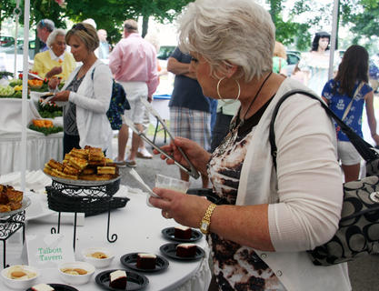 Janice Botts, of Glasgow, Ky., decides which dessert she wants during the Doo Dah Day reception in front of the J. Dan Talbott Amphitheatre Saturday.